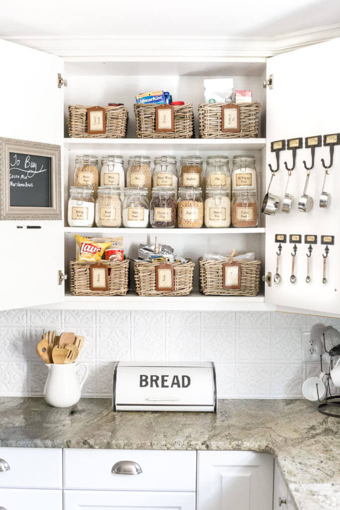 I'm always looking for easy kitchen organization ideas, and these DIY budget-friendly tips! Bless'er House's DIY pantry is full of great kitchen DIY's, vintage farmhouse charm, and free printables! #KitchenOrganization #KitchenOrganizationDIY #kitchentips #kitchenideas #organization #organizationideas
