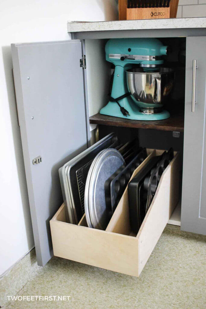 I'm always looking for easy kitchen organization ideas, and these DIY budget-friendly tips are genius! Awesome DIY solution to organizing baking pans from Two Feet First! Cheap & easy DIY! #kitchentips #kitchenideas #organization #organizationideas