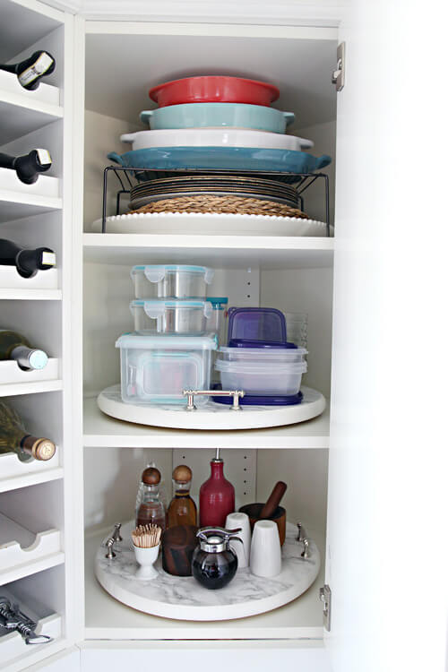 I'm always looking for easy kitchen organization ideas, and these DIY budget-friendly tips are genius! This glammed up DIY corner cabinet Lazy Susan from IHeart Organizing is my all time favorite! #kitchentips #kitchenideas #organization #organizationideas