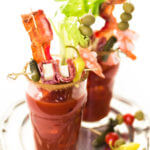 Keto Bloody Mary Recipe. If you're following a low carb ketogenic diet check out this amazing keto Bloody Mary cocktail recipe! The perfect keto drink to serve at brunch & parties! This New Orleans style Keto Bloody Mary recipe is the best with just the right amount of spice! Garnish with top shrimp, bacon or a salted rim! My favorite keto cocktail with vodka that won't blow my keto diet! #keto #ketosis #lowcarbcocktails #ketococktails #ketodrinks #ketoalcohol #lowcarbalcohol