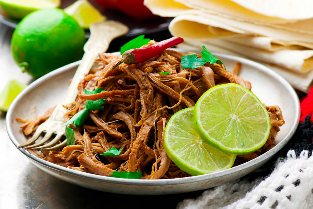 Looking for a keto dinner recipe that's low carb high in flavor & easy to prep for your crockpot? Check out this Keto Crockpot Carnitas recipe! Authentic pulled pork with 5 net carbs! Everyone will love this easy keto recipe that's perfect for ketogenic diet beginners-no special ingredients necessary! You can't beat a slow cooking keto meal made easy in the crockpot! #keto #ketocarnitas #ketorecipes #ketodinner #lowcarb #lowcarbrecipes #crockpot #crockpotrecipes #InstantPot #slowcooker