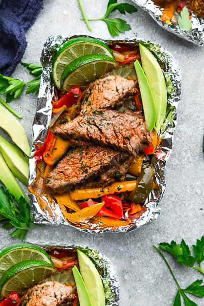 60+ Low Carb and Keto Grilling Recipes perfect for summer dinners, cookouts, and parties! The best quick and easy keto BBQ recipes to help you stick to your healthy eating plan! Plenty of variety with chicken, steak, shrimp, pork and sides! Don't miss these fabulous keto grilling recipes! #keto #ketorecipes #grill #grilling #grilled