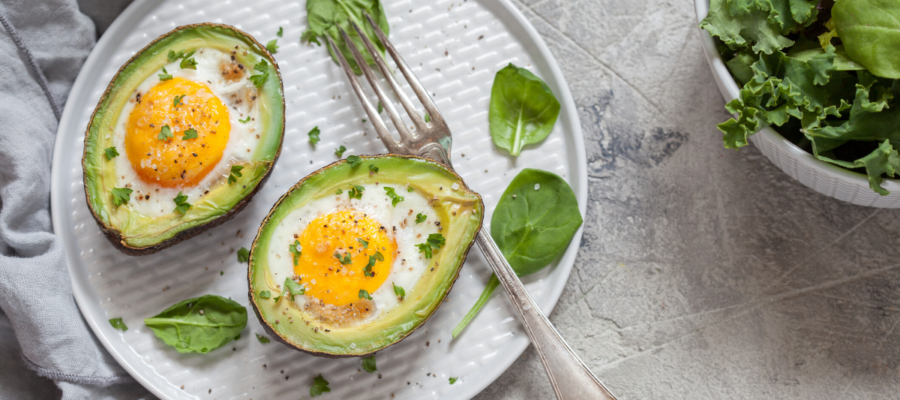 Why Avocado Baked Eggs Are The True Breakfast of Champions (Healthy Egg Stuffed Avocado Recipe)