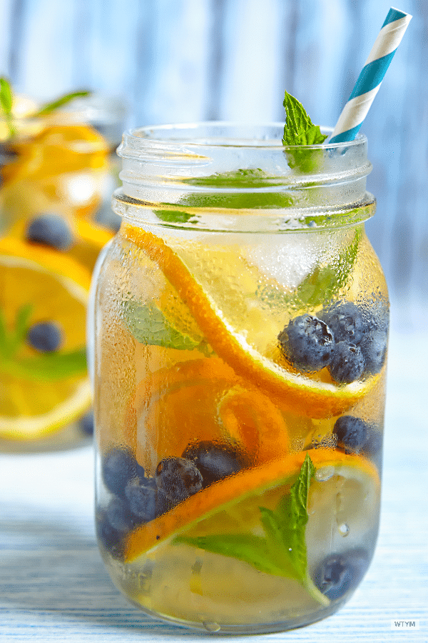 Lose weight with these fat burning detox water recipes! Whether you're looking for flat belly water for bloating or detox recipes for a body flush cleanse you'll love this collection of 20 detox water recipes! The Jillian Michaels recipe helped me lose 10 lbs! Infused with healthy fruits like pomegranate, strawberry, lemon & ginger detox water comes with lots of health benefits from boosting energy to clear skin! #detoxfoods
