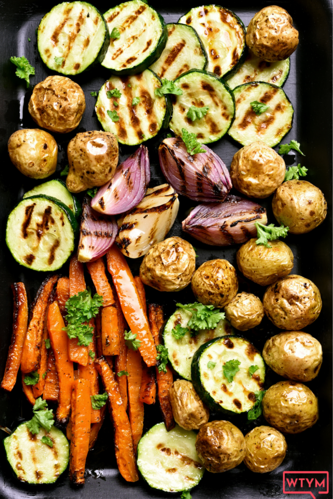 Make the BEST Rainbow Roasted Vegetables with this easy healthy recipe! Learn how to Roast Vegetables in the oven with this quick Sheet Pan method with seasoning ideas, veggie cooking tips and times, plus more recipe ideas. Healthy Oven Roasted Vegetables are a delicious side dish for any meal. Roasted Veggies are perfect for meal prep, quick weeknight meals, or serving a crowd during the holidays like Thanksgiving! Vegan + Gluten-Free +low carb options